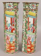 A PAIR OF 19TH/20TH CENTURY CHINESE CANTON CYLINDRICAL PORCELAIN SLEEVE VASES, circa 1900, painted in typical palette with figural and floral panels, each base with a four-character Qianlong mark, 12.1in high.