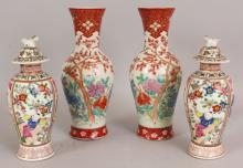 A PAIR OF JAPANESE HICHOZAN SHIMPO PORCELAIN VASES, circa 1900, each base with a maker's mark, 10in high; together with a pair of Arita famille rose porcelain vases & covers, each 8in high overall. (4)