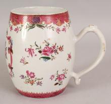 A CHINESE QIANLONG PERIOD FAMILLE ROSE PORCELAIN TANKARD, the barrel form body painted with loose floral sprays, 5.25in wide at widest point & 6.1in high.