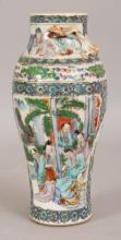 A 19TH CENTURY CHINESE FAMILLE VERTE PORCELAIN VASE, painted with figural panels, 8.7in high.