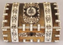 ANOTHER SMALLER 19TH/20TH CENTURY INDIAN VIZAGAPATUM STYLE IVORY & HORN RECTANGULAR BOX, with domed and hinged cover, the interior lined with sandalwood, the horn exterior onlaid with black engraved ivory panels, borders and studs, 6.3in x 4.75in x 3.1in high.