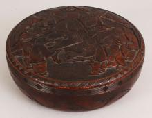 AN EARLY 20TH CENTURY SIGNED CHINESE CIRCULAR WOOD BOX & COVER, the cover carved with a scene of a Mandarin and children, the base with an incised signature, 10.2in diameter & 3.7in high.