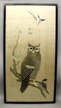A GOOD QUALITY LARGE 19TH/20TH CENTURY FRAMED CHINESE SILK EMBROIDERY OF AN OWL, seated on a leafy branch beneath butterflies and a bird in flight, the frame 40.5in x 21.5in.