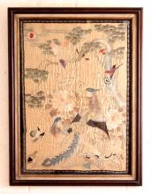 A GOOD QUALITY 19TH/20TH CENTURY FRAMED CHINESE SILK GROUND EMBROIDERY, decorated in elaborate detail with a peacock and peahen amidst peony, rockwork and small birds, beneath an overhanging branch that bears a golden pheasant, the frame 32.25in x 24.25in.