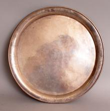 AN EARLY 20TH CENTURY CHINESE SILVER PRESENTATION SALVER BY WANG HING, of circular form with four bun feet, the centre with an inscription dated 7th April 1932, the base with impressed character mark and 'WH90', 11.1in diameter.