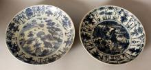 TWO SIMILAR LARGE CHINESE WANLI PERIOD KRAAK PORCELAIN DISHES, of saucer shape, one painted to its centre with two deer-like creatures in a landscape setting, the other with a peacock beside peony, rockwork and bamboo, 14.3in & 13.8in diameter. (2)