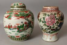 AN 18TH/19TH CENTURY CHINESE FAMILLE ROSE BALUSTER VASE, painted with a peacock perched on rockwork beside peony, 8.8in high; together with an early 20th Century Chinese famille verte jar & cover, the base with a six-character Kangxi mark, 8.3in wide at widest point & 10in high overall.