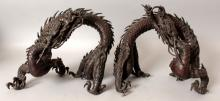 A GOOD LARGE PAIR OF JAPANESE MEIJI PERIOD BRONZE DRAGONS, each sinuous creature with naturalistically cast overlapping scales, 11in wide & 10.25in high.