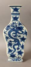 A FINE QUALITY 19TH CENTURY CHINESE BLUE & WHITE PORCELAIN DRAGON & PHOENIX VASE, of rectangular section and baluster form, the main sides each painted with a dragon pursuing a flaming pearl amidst flame and cloud scrolls, the remaining sides each with a phoenix, the base with an artemisia leaf mark, 4.9in wide at widest point & 11.6in high.