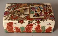 AN EARLY 20TH CENTURY SIGNED JAPANESE RECTANGULAR SATSUMA EARTHENWARE BOX & COVER, the cover painted with two overlapping panels of geisha and of a landscape scene, the panels reserved on a ground of flowers and foliage, the base with a maker's mark, 5.1in x 3in x 1.8in high.