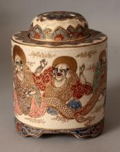 A SIGNED JAPANESE MEIJI PERIOD IMPERIAL SATSUMA EARTHENWARE KORO & COVER, the sides of the cylindrical body painted with sennin in the company of a dragon, the base with a Satsuma mon & signature, 3.8in diameter at base & 4.9in high overall.