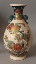 A SIGNED JAPANESE MEIJI PERIOD IMPERIAL SATSUMA EARTHENWARE VASE, the sides of the pear-form body well painted with arrangements of chrysanthemum and leafage, the base with a Satsuma mon and signatures, 8.5in high.