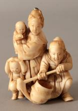 A GOOD QUALITY JAPANESE MEIJI PERIOD IVORY OKIMONO OF A FARMER & HIS FAMILY, the farmer squatting and holding a hoe, his inro with onlaid hardstones as ojime, 2.4in high.