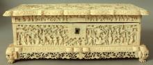 A FINE QUALITY LARGE 19TH CENTURY CHINESE CANTON SHAPED RECTANGULAR IVORY CASKET WITH HINGED COVER, the cover carved in deep relief with barbed quatrefoil figural panels reserved on an unusual ground of sheep, water buffalo, deer and other animals in a forest setting, the sides with similar figural and animal scenes, 11.5in wide x 5.5in deep x 4.25in high.
