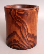 A CHINESE NANMU HARDWOOD BRUSHPOT, with good grain and waisted sides, 5.3in diameter at rim & 6in high.