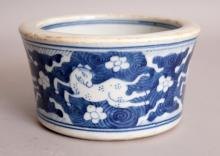 A CHINESE KANGXI STYLE BLUE & WHITE PORCELAIN BRUSHPOT, the flaring sides decorated with gambolling horses against a whorl ground, 5.8in diameter & 3.25in high.