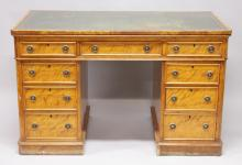 A GOOD VICTORIAN SATIN BIRCH PEDESTAL DESK with inset leather top, three frieze drawers, three drawers to each pedestal with circular brass handles. <br>4ft 2ins wide, 2ft 4ins deep, 2ft 7ins high.