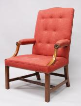 A GOOD GEORGIAN STYLE MAHOGANY GAINSBOROUGH ARMCHAIR with padded buttoned back, curving padded arms, on square legs.