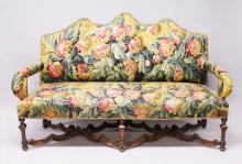 A GOOD WILLIAM & MARY WALNUT FRAME TRIPLE CAMEL BACK SETTEE, with floral needlework tapestry cover, on square tapering legs with cross stretchers. <br>6ft long.