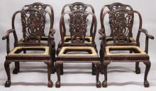 A GOOD SET OF SIX IRISH CHIPPENDALE DESIGN HEAVY MAHOGANY DINING CHAIRS, two with arms, the pierced backs with garlands and ribbons, with drop-in seats, carved frieze and supported on claw and ball feet.