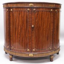 A GOOD ADAM DESIGN MAHOGANY DEMILUNE SIDEBOARD, with plain top, arcaded frieze with patria, central door flanked by panels and supported on turned legs. <br>3ft 6ins long, 1ft 7ins deep, 3ft 3ins high.