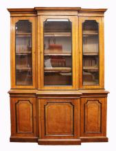 A GOOD 19TH CENTURY OAK BREAKFRONT BOOKCASE by R. GARNETT & SONS, the top with three glass panel doors enclosing adjustable shelves with panel doors below, on a platform base. <br>7ft 10ins high, 5ft 8ins wide, 1ft 7ins deep overall.