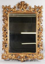 A GOOD 1920'S CARVED AND GILDED ITALIAN MIRROR. <br>Overall size 3ft 7ins high, 2ft 5ins wide.