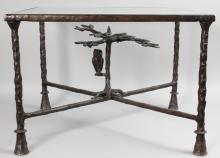 DIEGO GIACOMETTI STYLE <br>A SUPERB BRONZE COFFEE TABLE with inset plate glass top, the base with tree design and leaves. <br>2ft long, 1ft 10ins wide, 1ft 5ins high.