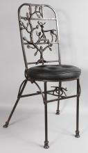 DIEGO GIACOMETTI STYLE <br>A SUPERB BRONZE CHAIR with studded leather seat, the frame with tree design and deer.