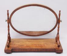 A VICTORIAN MAHOGANY DRESSING TABLE MIRROR with large oval mirrored panel. <br>2ft 4ins wide.