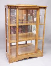 A GOOD EARLY 19TH CENTURY BIEDERMEIER MAPLE WOOD BREAKFRONT CHINA CABINET, with glass sides and central glass door, enclosing shelves and mirrored back.