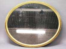 A LARGE GEORGIAN OVAL MIRROR with gilt wood frame. <br>3ft 8ins wide, 3ft 2ins high.