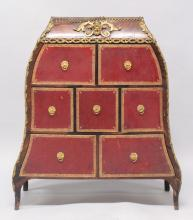 AN 18TH CENTURY LOUIS XVI KINGWOOD CARTONIERE with ormolu mounts and seven drawers of various sizes. <br>2ft 8ins high, 1ft 10ins wide.
