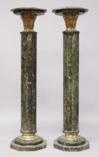 A GOOD PAIR OF GREY MARBLE COLUMNS, with square tops and cluster column supports. <br>3ft 7ins high.
