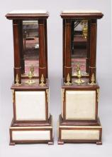 A GOOD PAIR OF MAHOGANY AND MARBLE COLUMNS, with mirrored backs. <br>3ft 7ins high.