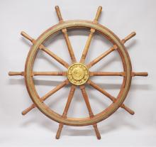 A LARGE WOODEN SHIPS WHEEL. <br>5ft 8ins diameter.
