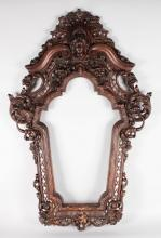 A GOOD ITALIAN CARVED AND PIERCED MAHOGANY FRAME. <br>3ft 10ins high, 2ft 4ins wide.