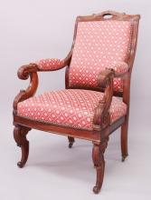 A GOOD REGENCY ROSEWOOD THOMAS HOPE DESIGN ARMCHAIR, with padded back, arms and seat, supported on curving legs.