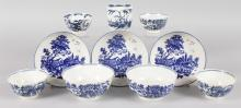 AN 18TH CENTURY WORCESTER COFFEE CUP painted with the Candle Fence pattern, three saucers in the European Landscape pattern, three tea bowls in the Fence pattern and a Mansfield tea bowl, and two Fence pattern small bowls.