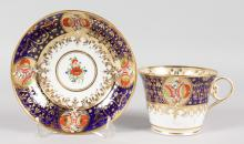 AN EARLY 19TH CENTURY CHAMBERLAIN WORCESTER BREAKFAST CUP AND SAUCER of Yero type, painted in imari pattern, No. 290, cup 3.25ins.