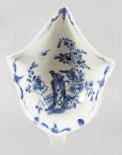 AN 18TH CENTURY WORCESTER PICKLE LEAF DISH painted with the Two Peony Rock Bird workman's mark.
