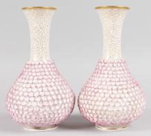 A PAIR OF ROYAL WORCESTER FLOWER ENCRUSTED BULBOUS VASES encrusted with flower heads. <br>Printed circular mark. <br>7.5ins high.