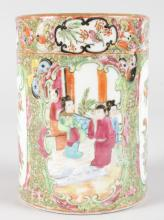 A CANTON PORCELAIN BRUSH POT with alternate panels of figures, birds and flowers. <br>5.5ins high.