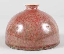 A CHINESE RED PORCELAIN CIRCULAR INK POT. <br>4.5ins diameter.