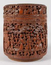 A CHINESE CARVED CIRCULAR BAMBOO POT AND COVER. <br>6ins high.