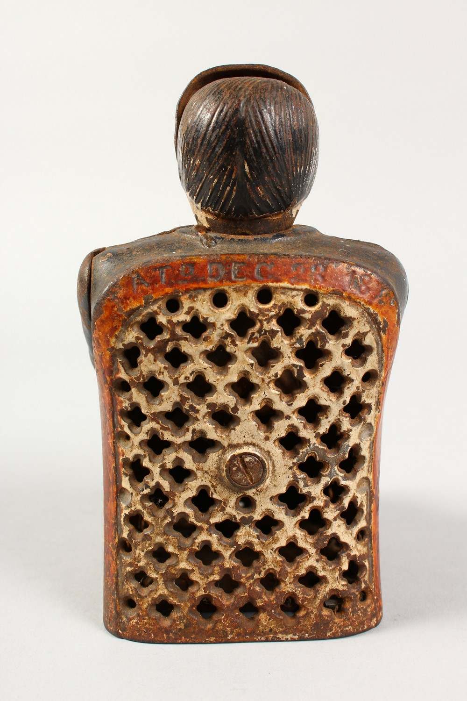 A VICTORIAN CAST IRON MONEY BOX,