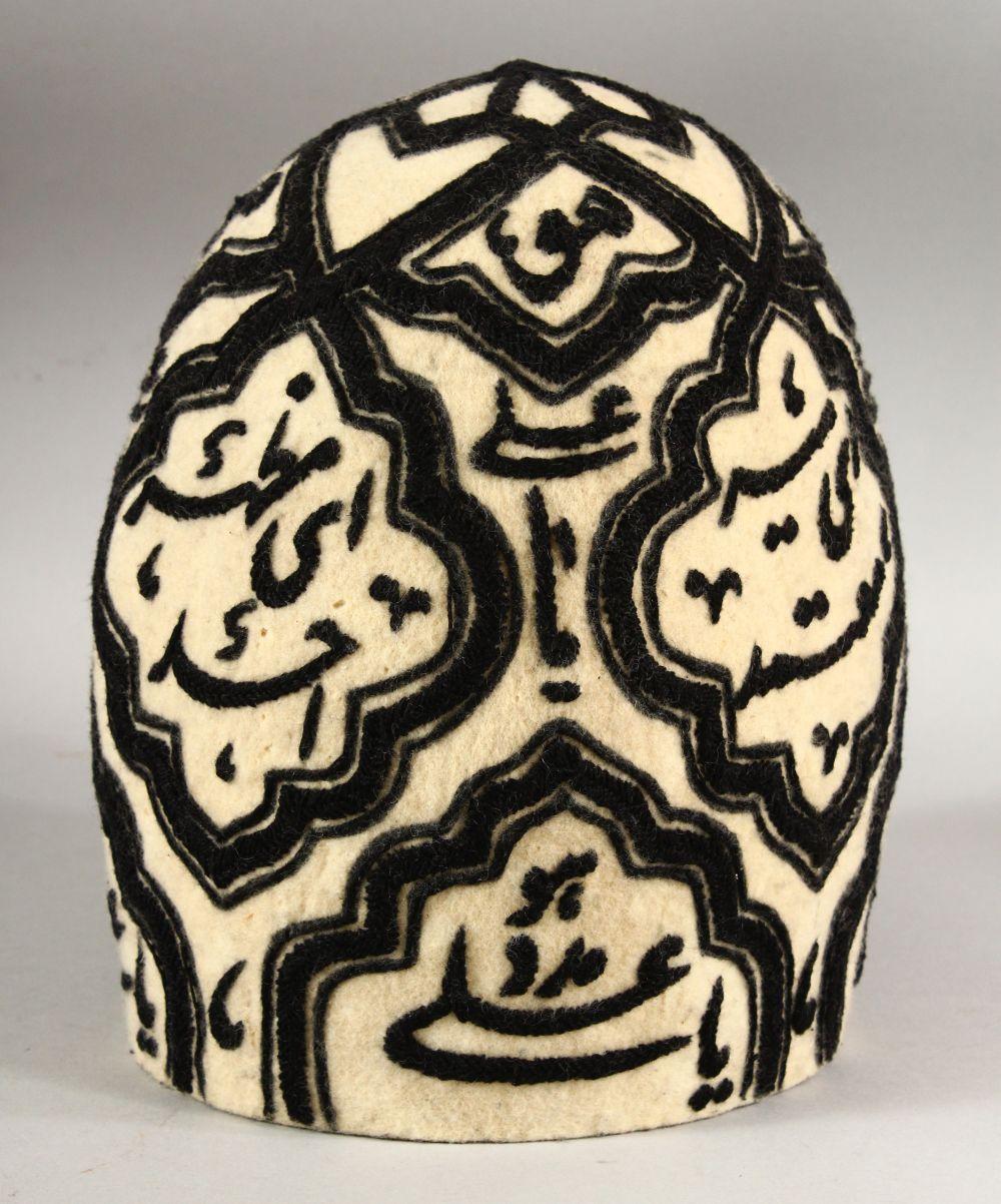 A GOOD PERSIAN QAJAR EMBROIDERED FELT SUFI DERVISH HAT, approx. height 21cm, approx. diameter 18cm.