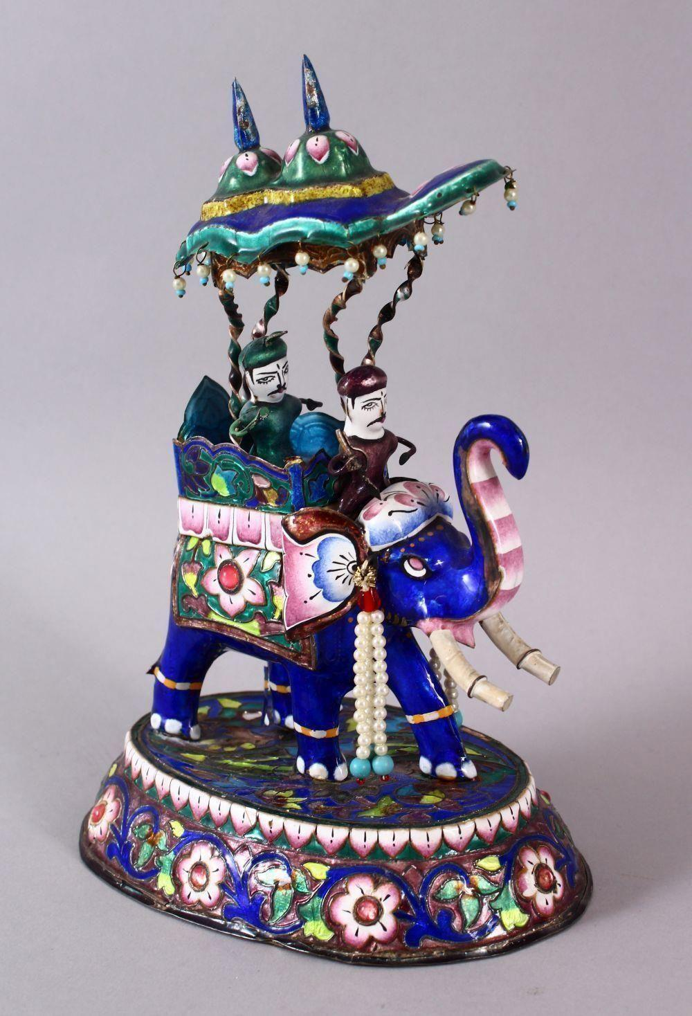 A 19TH / 20TH CENTURY INDIAN SILVER & ENAMEL MODEL OF AN ELEPHANT AND FIGURES, the elephant carrying two figur