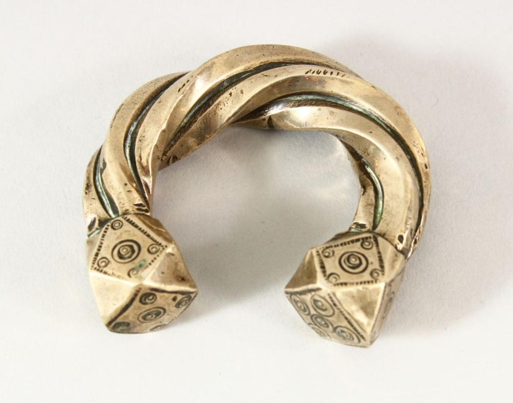 A SEJLUK WHITE METAL TWISTED BANGLE, The lower with a hall mark OR makers mark. 8cm