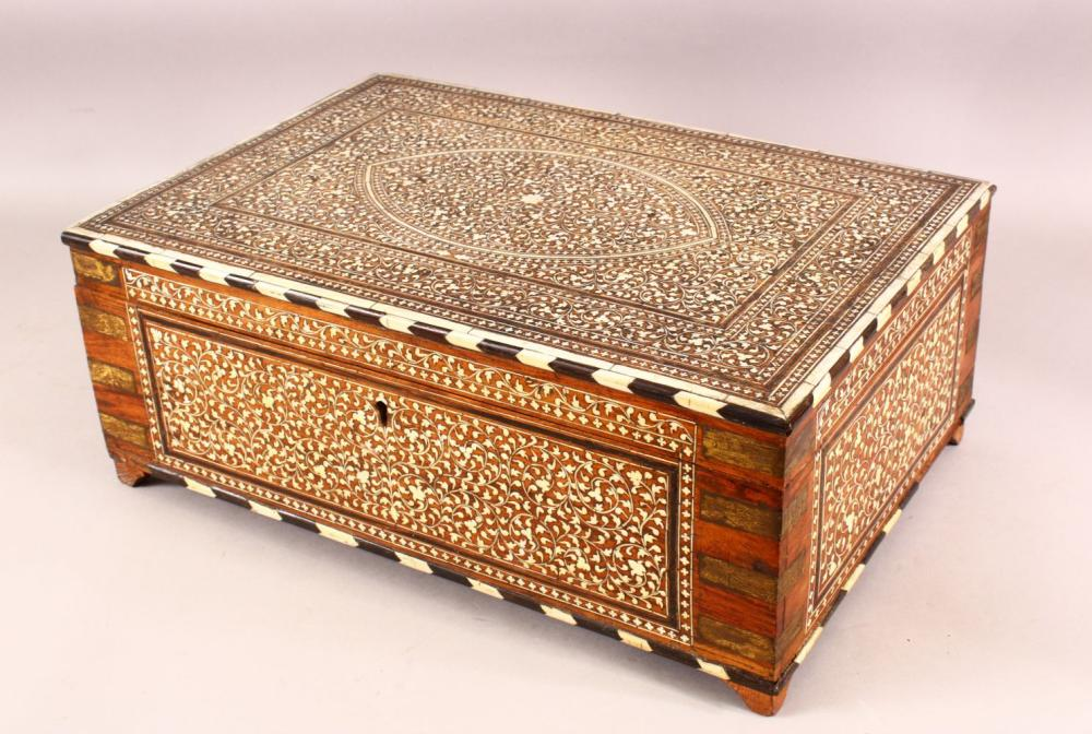 A FINE 19TH CENTURY INDO PERISAN INLAID BONE EBONY & BRASS VANITY BOX - the box profusely inlaid with carved b